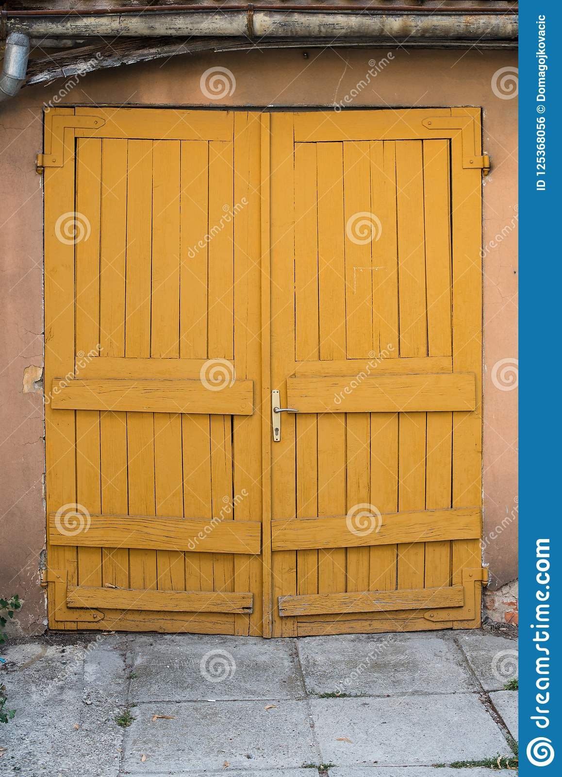 Old Closed Wooden Yellow Garage Doors Stock Photo Image Of Home