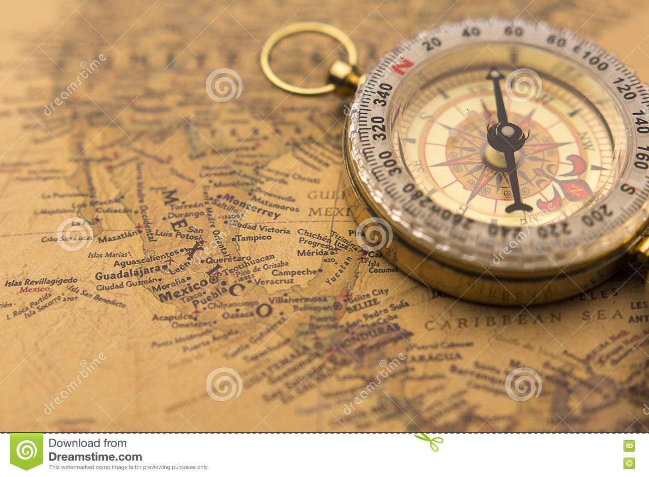 old compass on vintage map selective focus on mexico stock photo