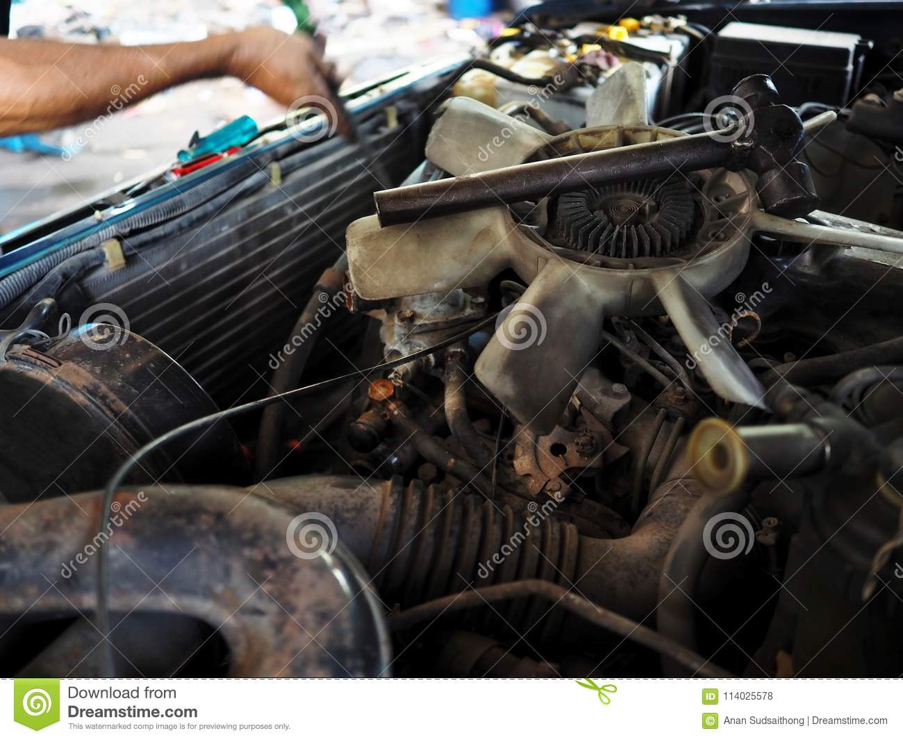 Old Cooling Fan Motor Of Car Is Being Removed In Garage Auto Repair Cool Download Service