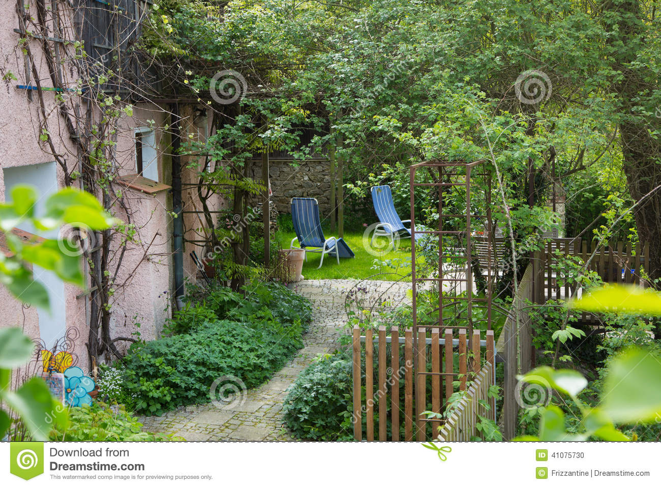 Old Cottage Garden From A Farm House In Summer Stock
