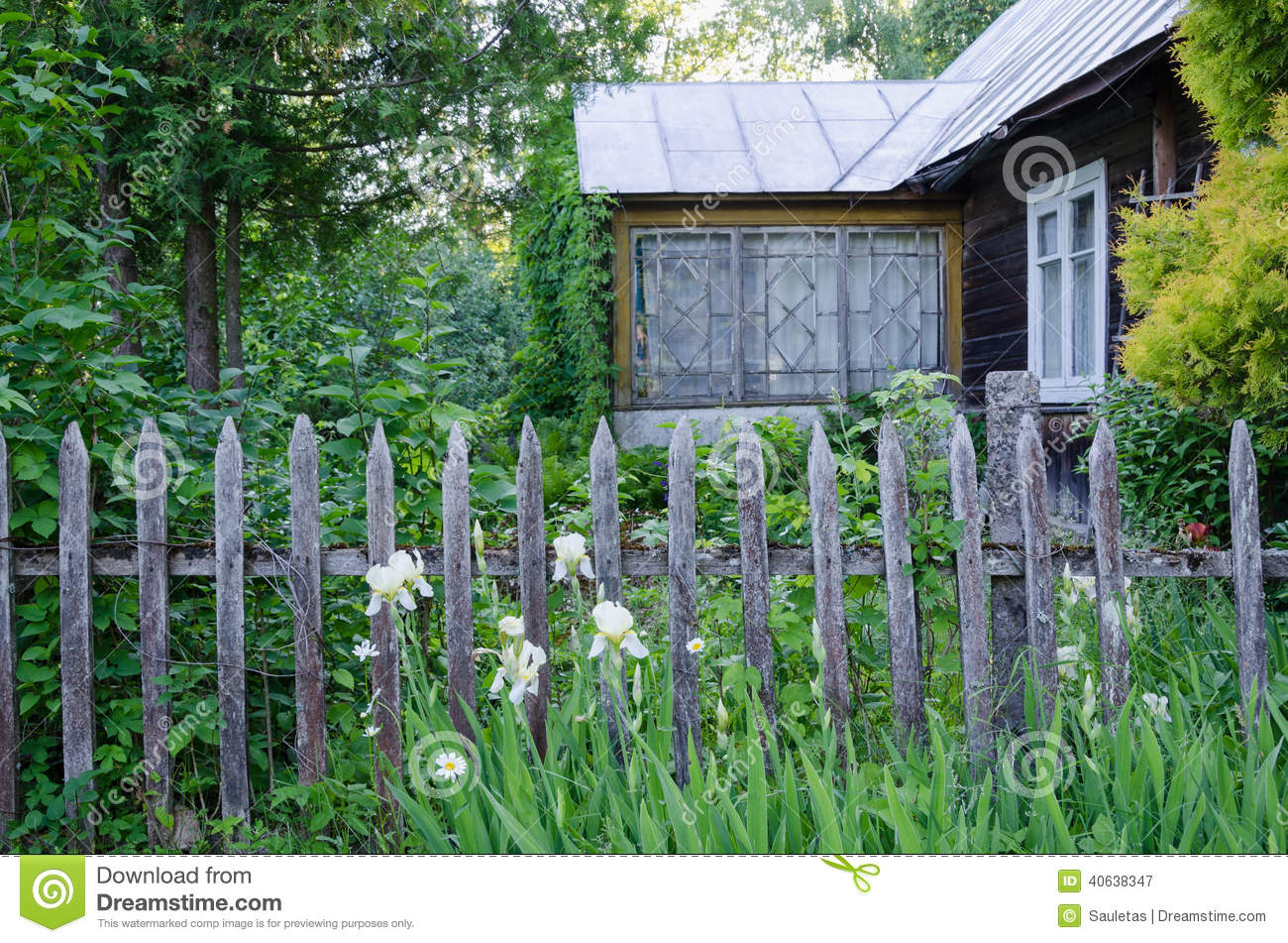 Old country house with porch and rustic wood fence stock for Casa de campo con jardin