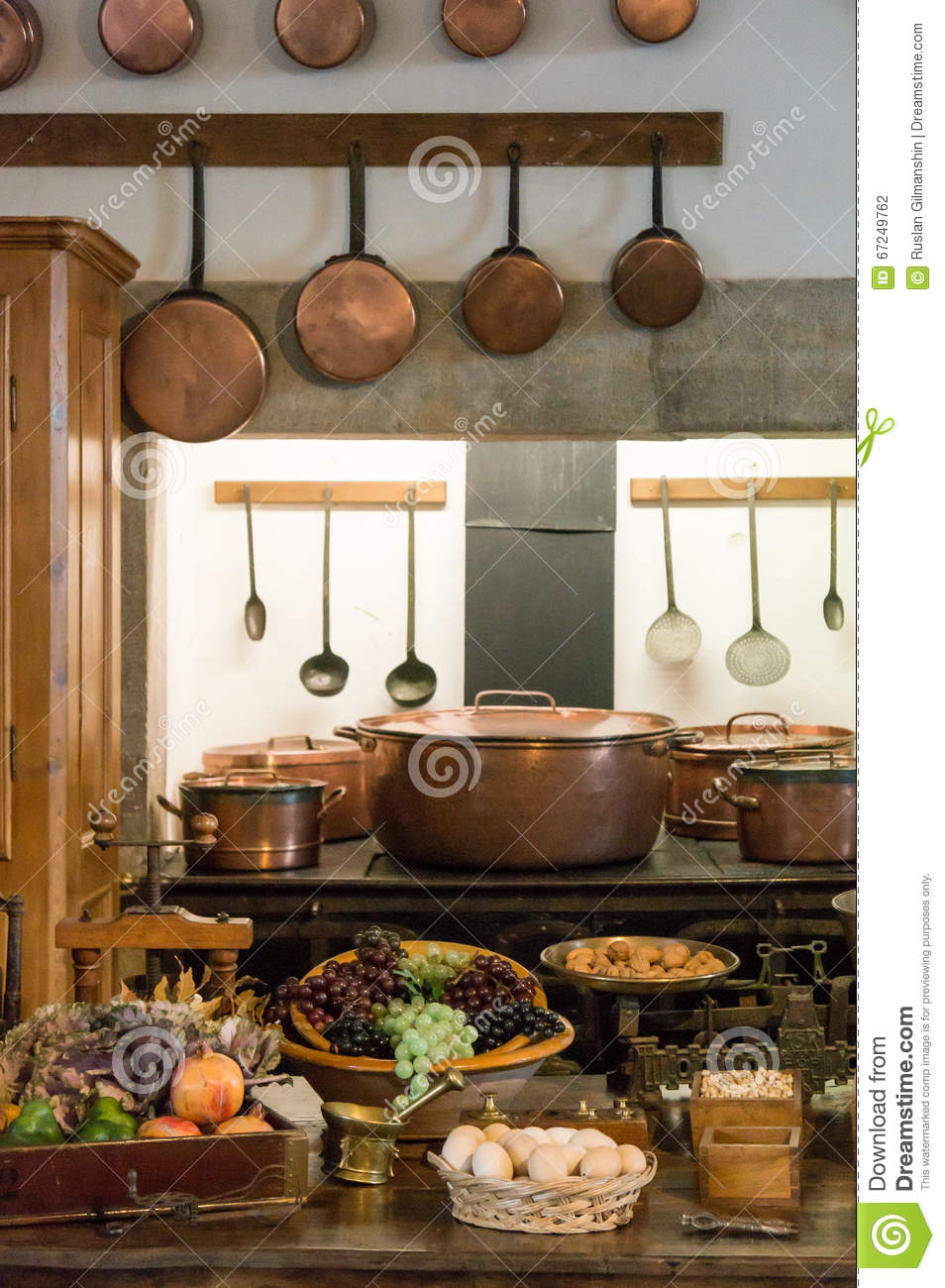 Old country style kitchen with copper pots stock photo for Old country style kitchen
