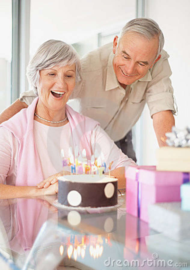 Old Couple Celebrating Womans Birthday At Home Stock Photo
