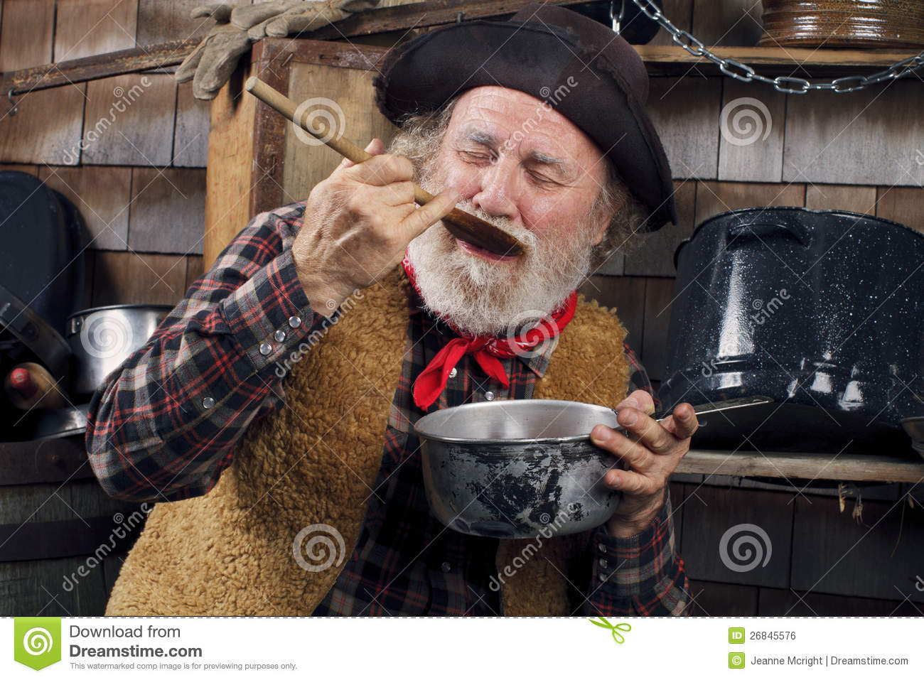 Old Cowboy Cook Tasting Food From Outdoor Kitchen Royalty