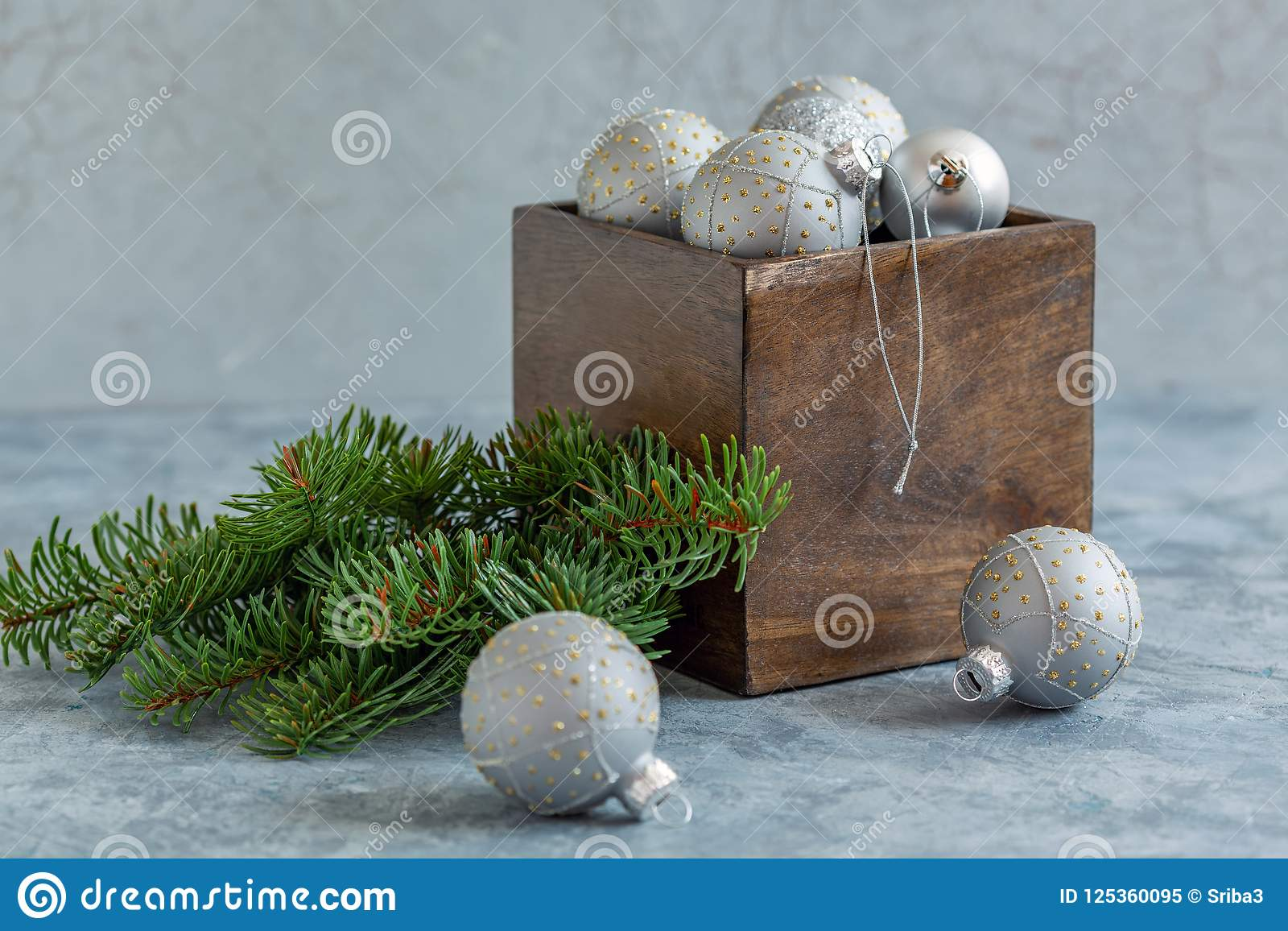 Christmas silver balls in an old wooden box.