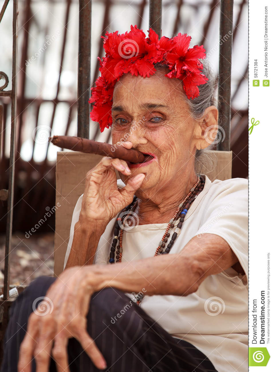 Old Cuban Lady Smoking Cigar. Stock Photo - Image: 58721384