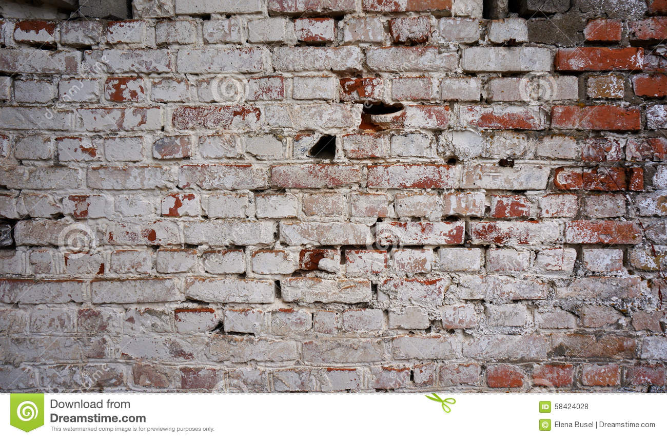 Old Dirty Brick Wall With Peeling White Paint Stock Photo
