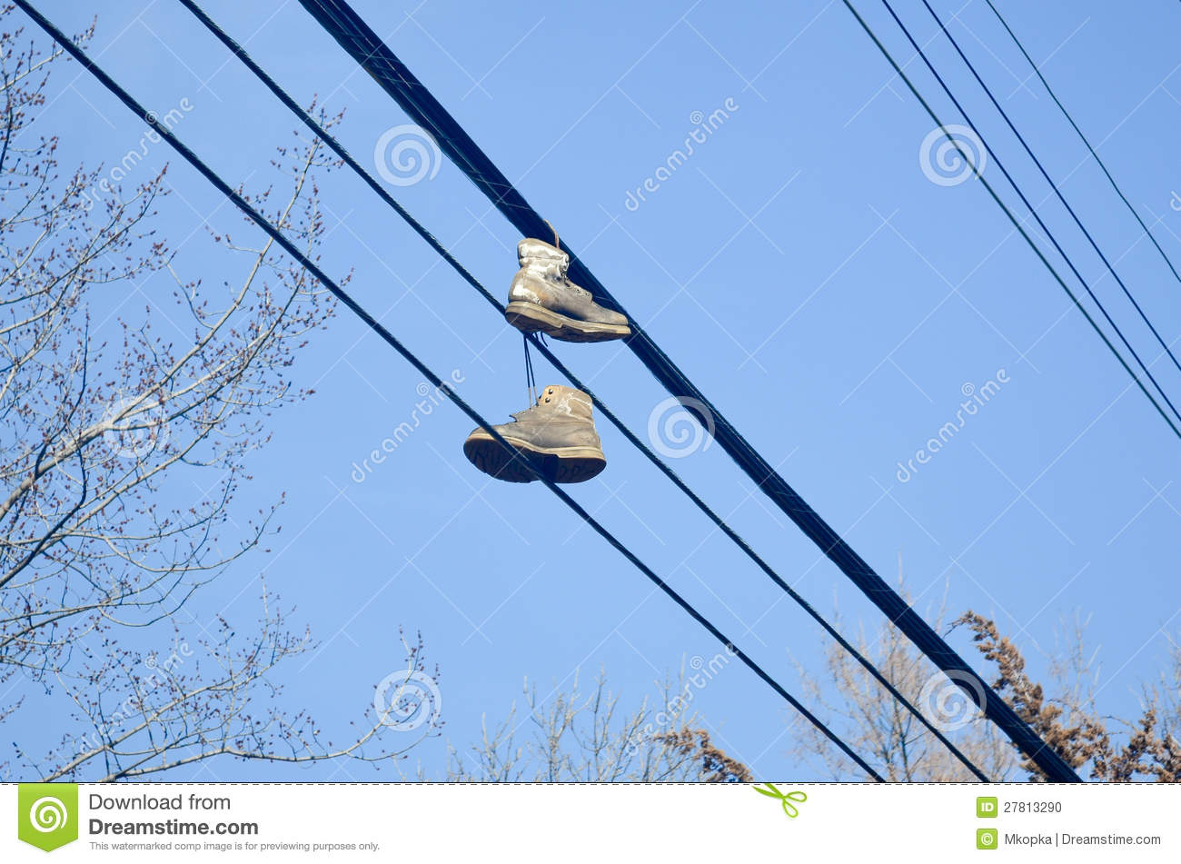 Shoes on power lines - urban scene, worn tennis shoes hanging from a