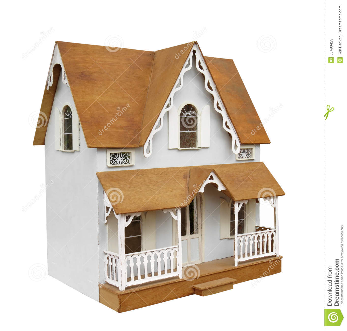 Old two-story home-made wooden doll house with porch. Isolated on ...