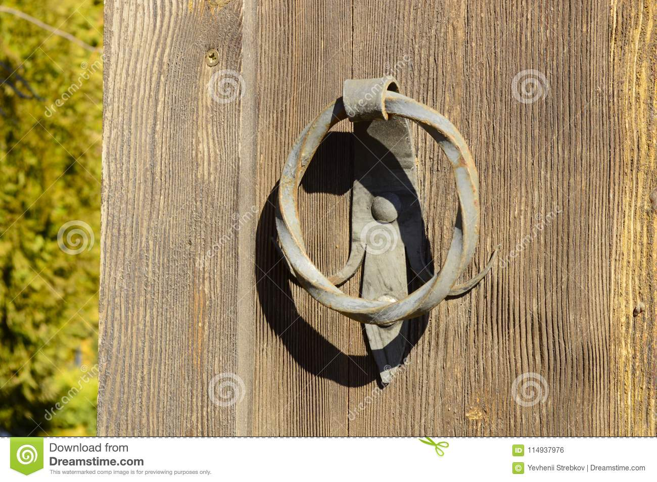 Old door with a forged handle
