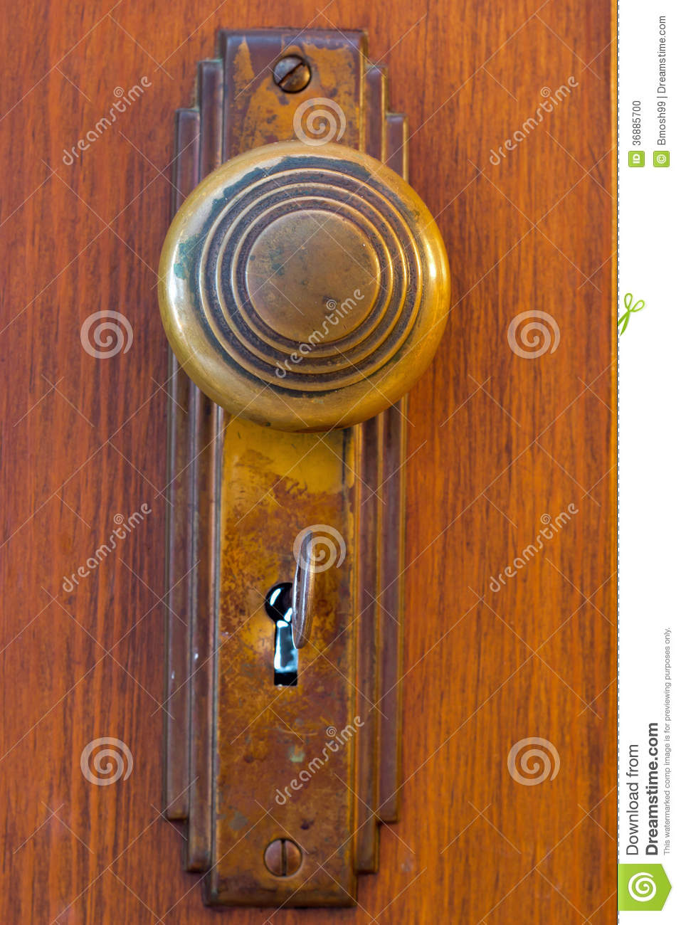 how to replace a keyhole door knob | Old Door knob with key stock photo. Image of wood, brass ...