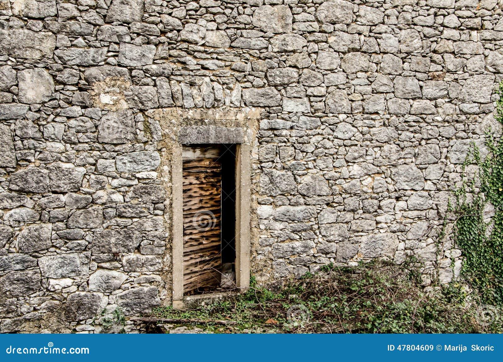 Old door on an old stone house in Dobrinj, island Krk, Croatia.