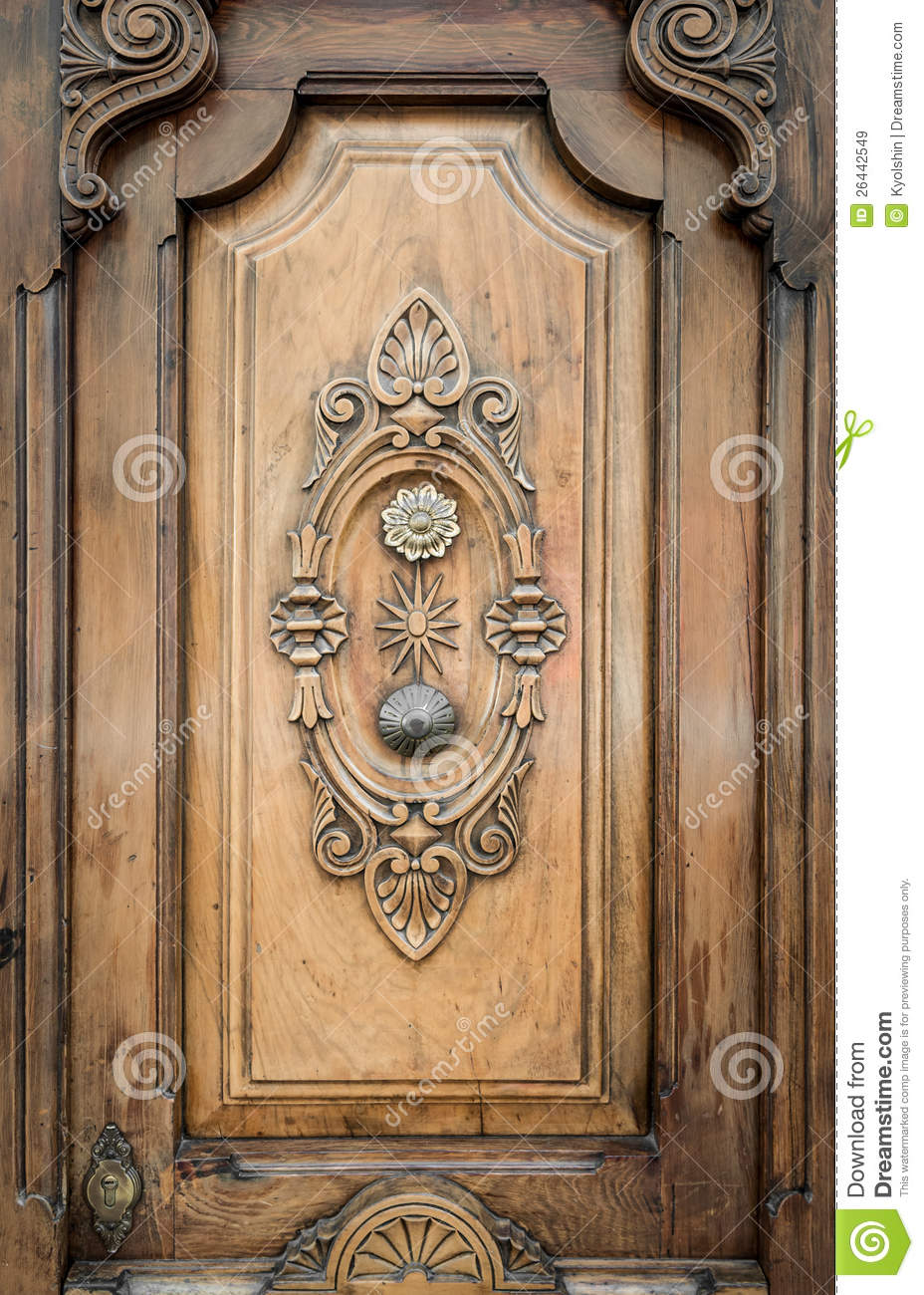 Old Door Of Wood With Patterns Carved On It. Royalty Free Stock ...