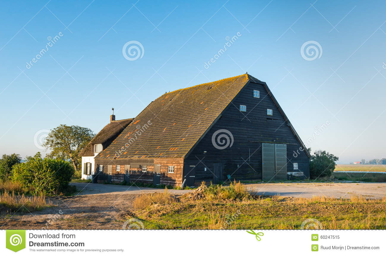 Old dutch farmhouse with barn stock image image 60247515 for Farm house netherlands