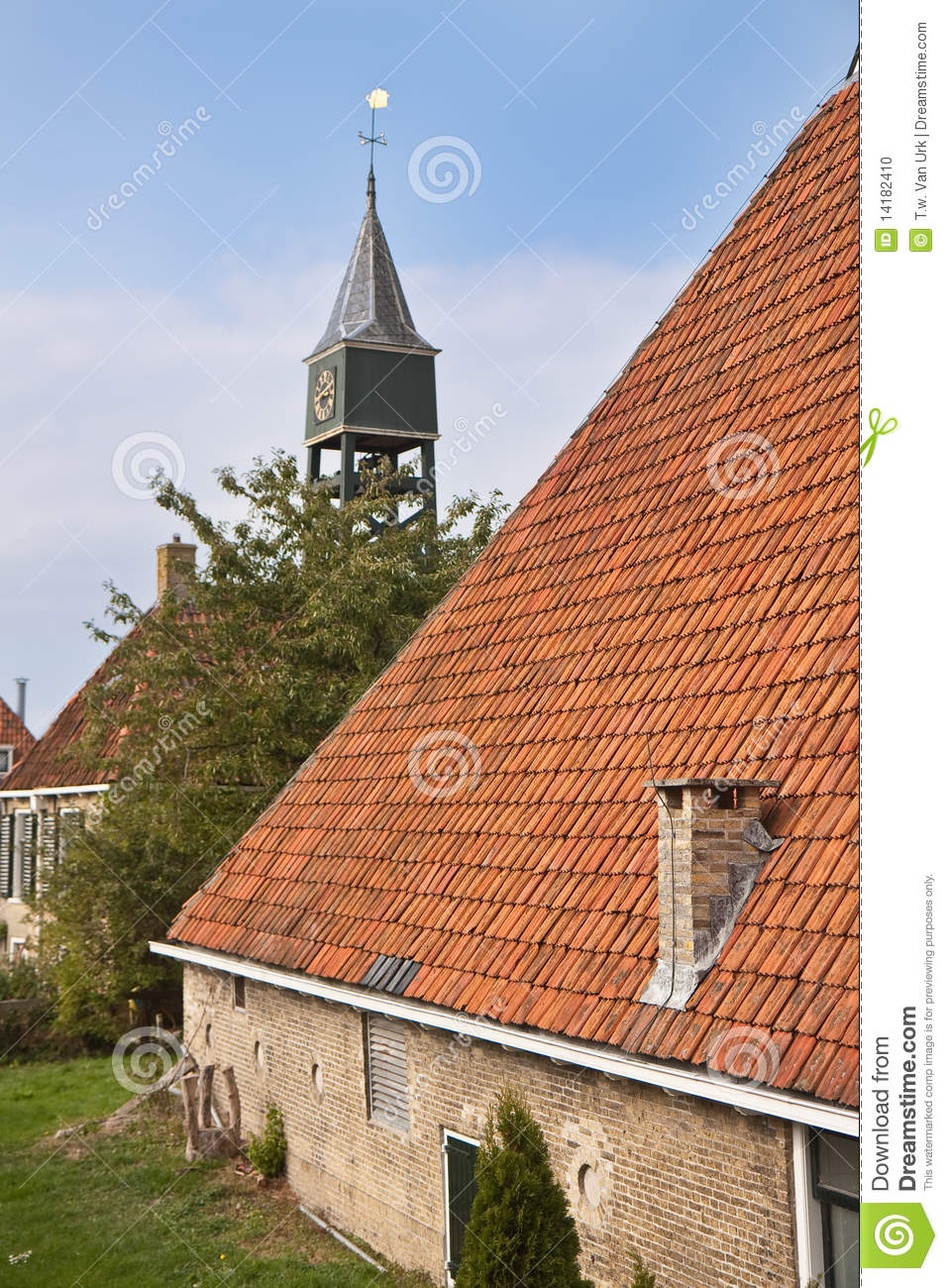 Old dutch farmhouse with churchtower behind it stock photo for Farm house netherlands