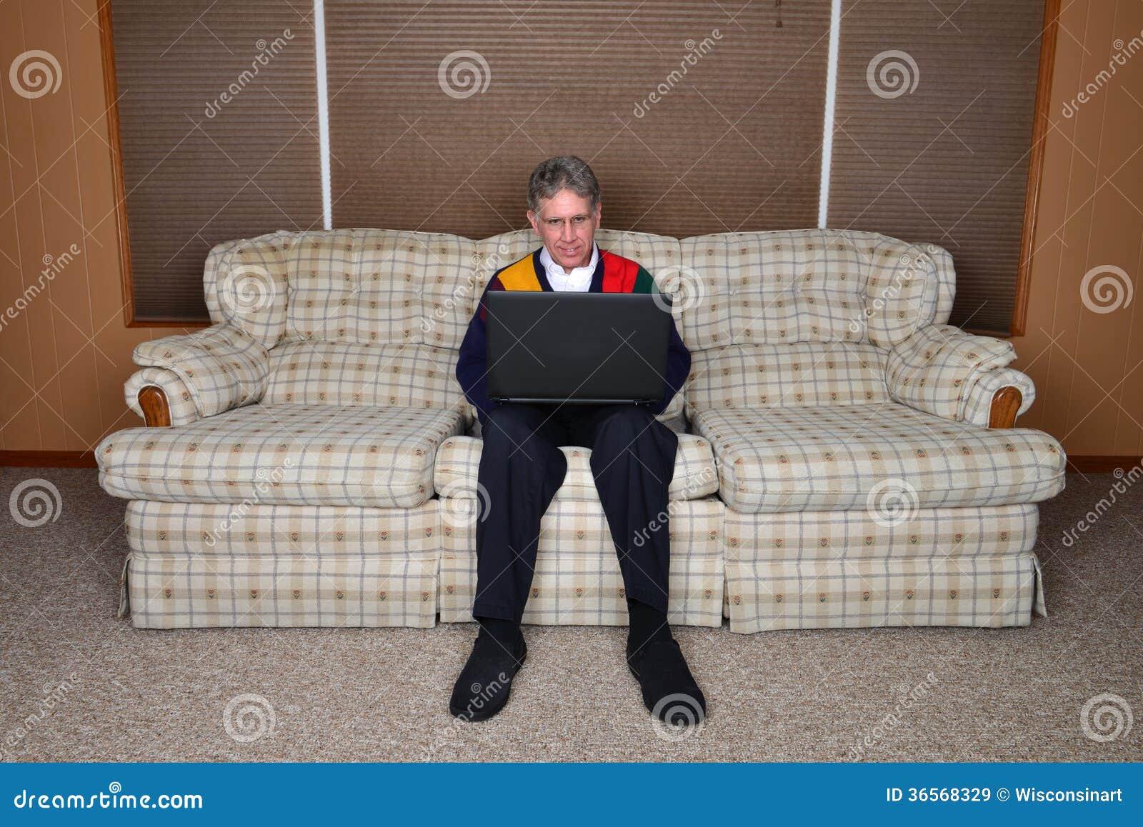 old elderly senior man using laptop computer royalty free. Black Bedroom Furniture Sets. Home Design Ideas