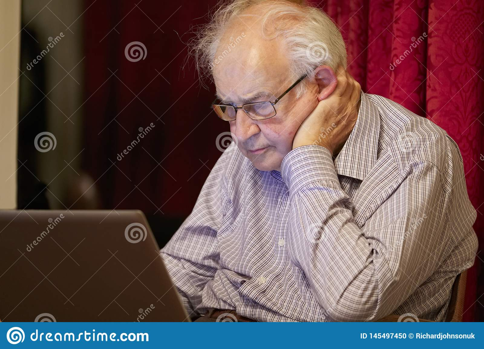 Old elderly senior person learning computer and online internet skills to prevent fraud