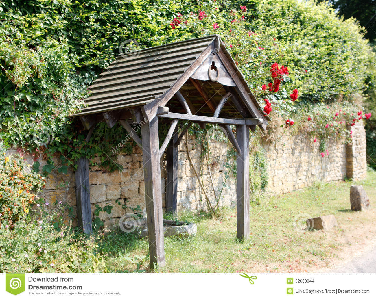 Old English Wooden Bus Stop With A Horseshoe Stock Photo