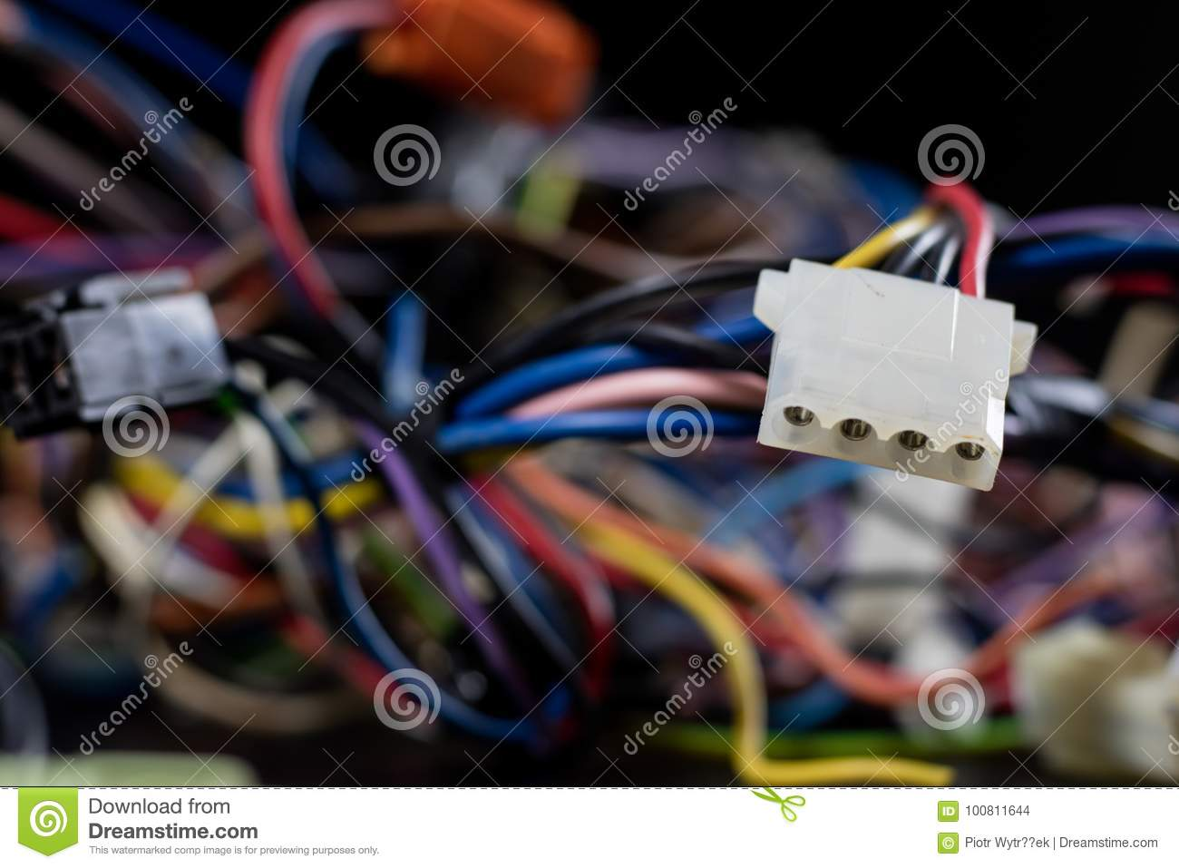 Old entangled cables, electronics and old cable connectors on a