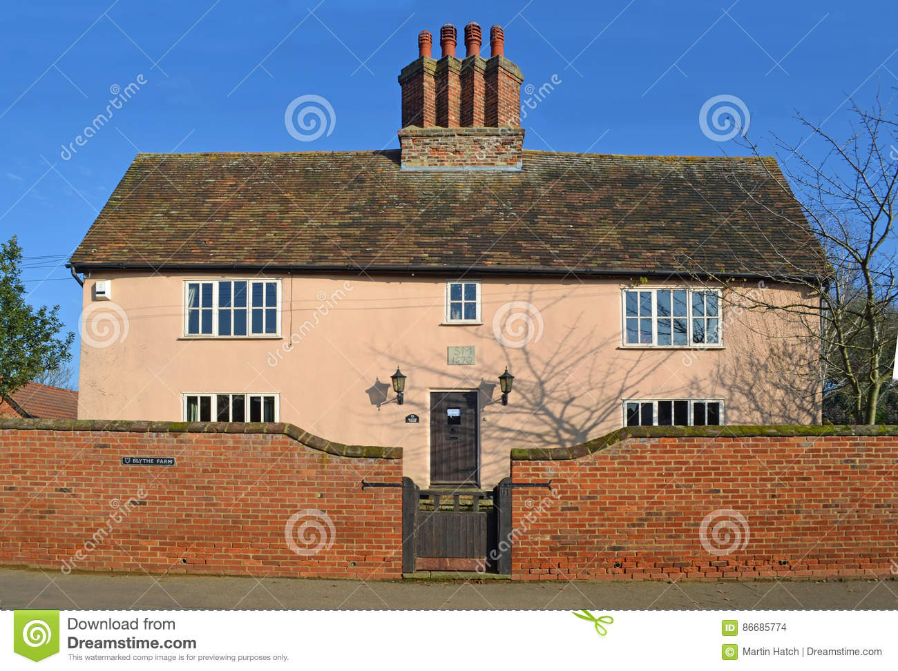 Old farm house with brick wall gate and period chimney for Farmhouse brick