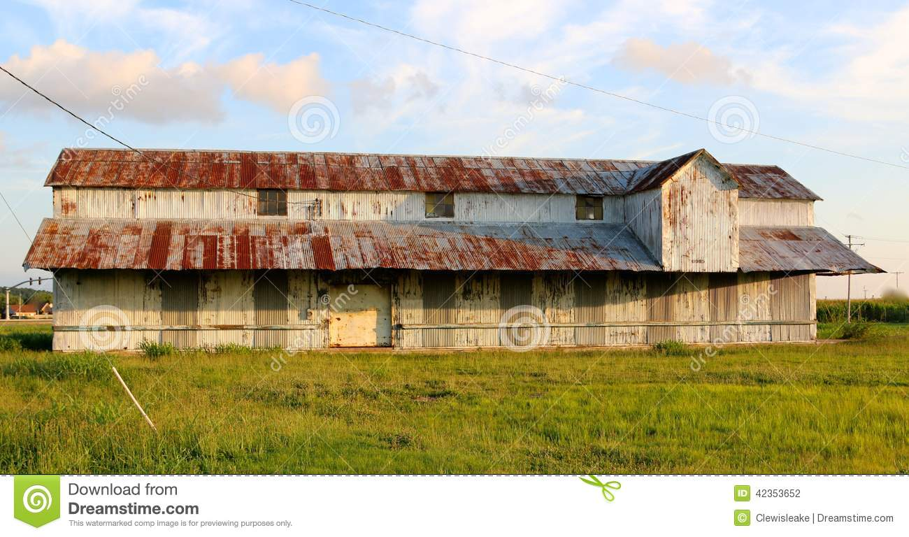 Old Farm House With Rustic Rusty Roof In The Mississippi Delta