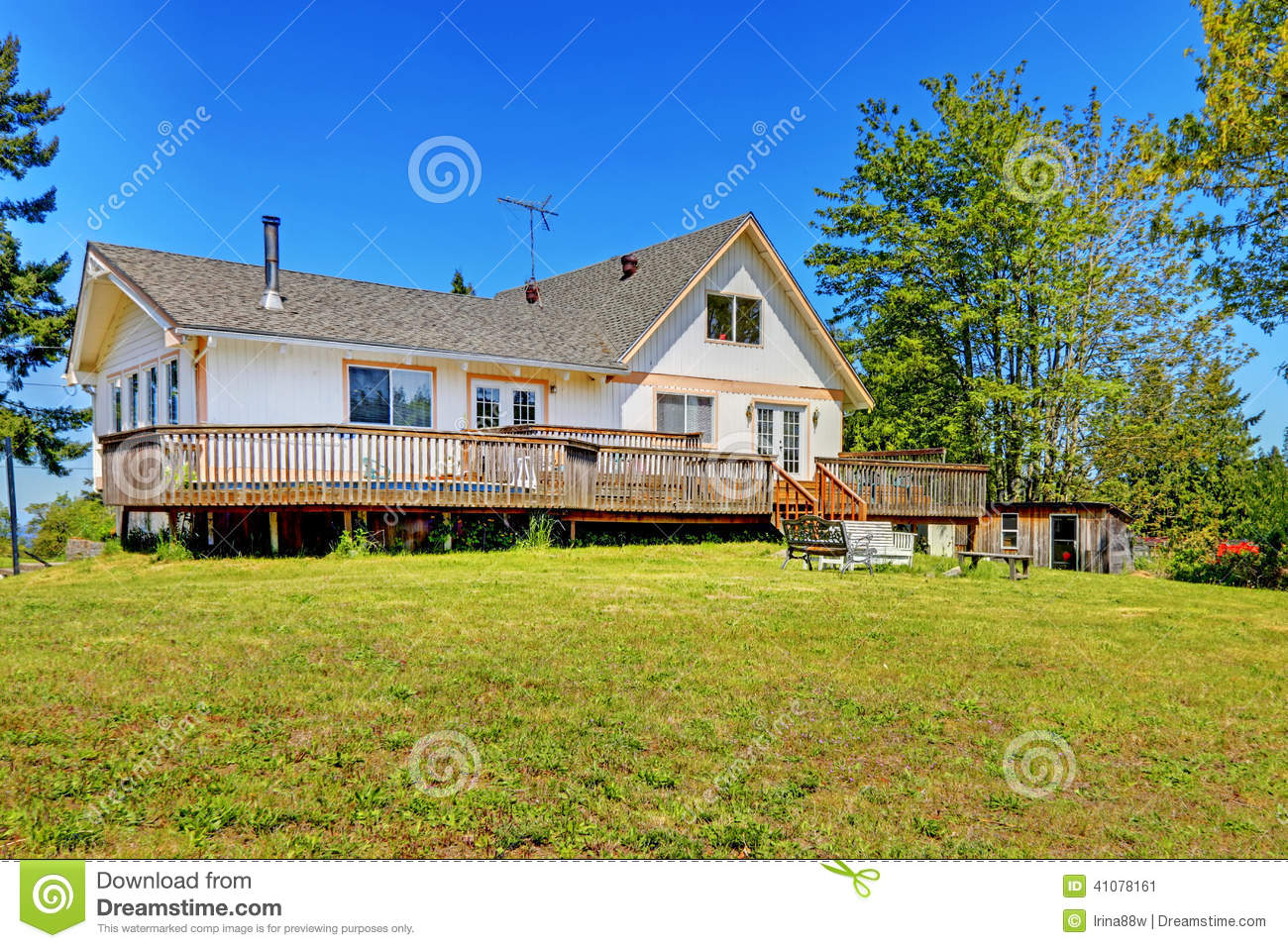 Old farm house with walkout deck backyard view stock for Pictures of small farm houses
