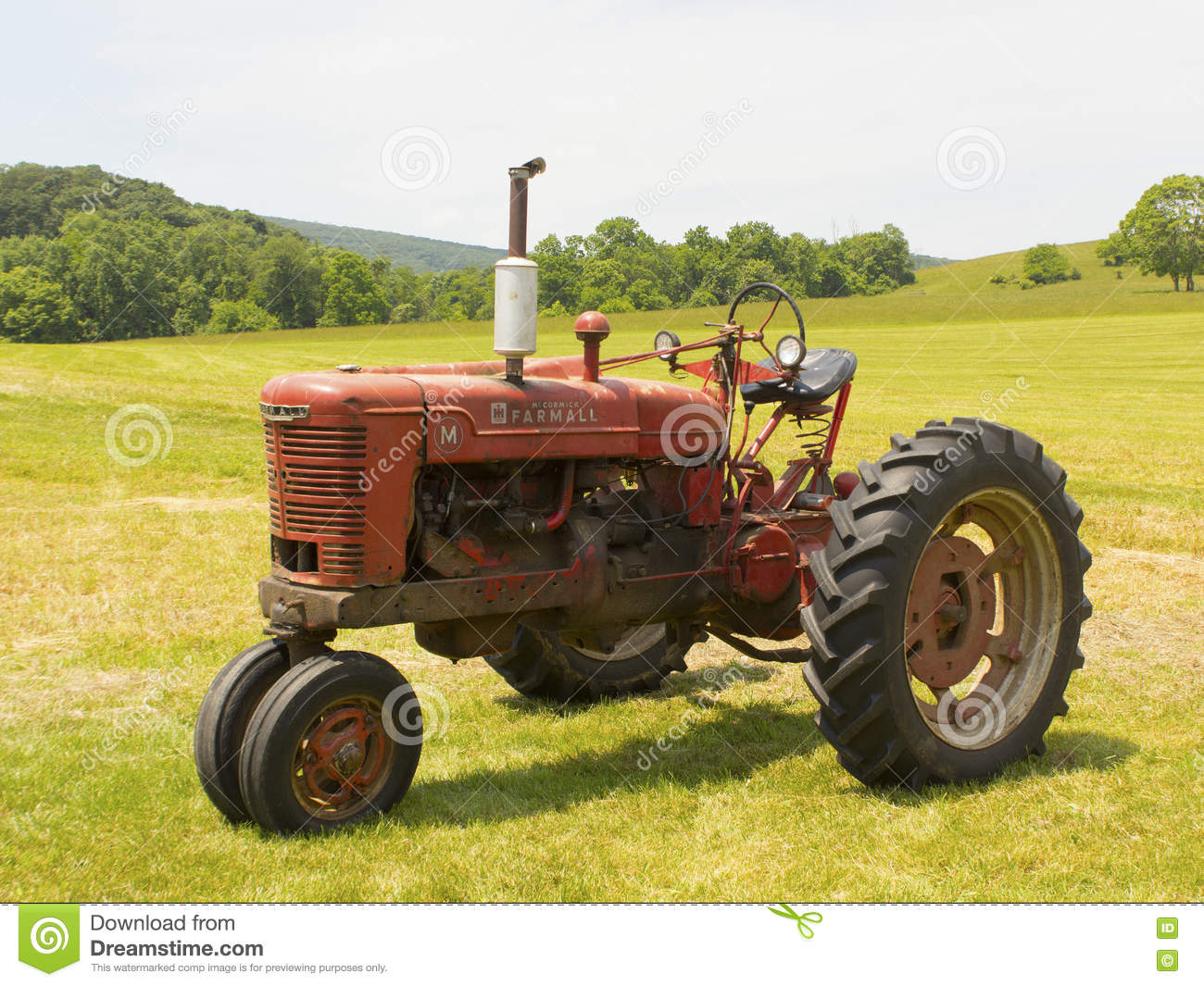 Old Farmall tractor sitting in a field