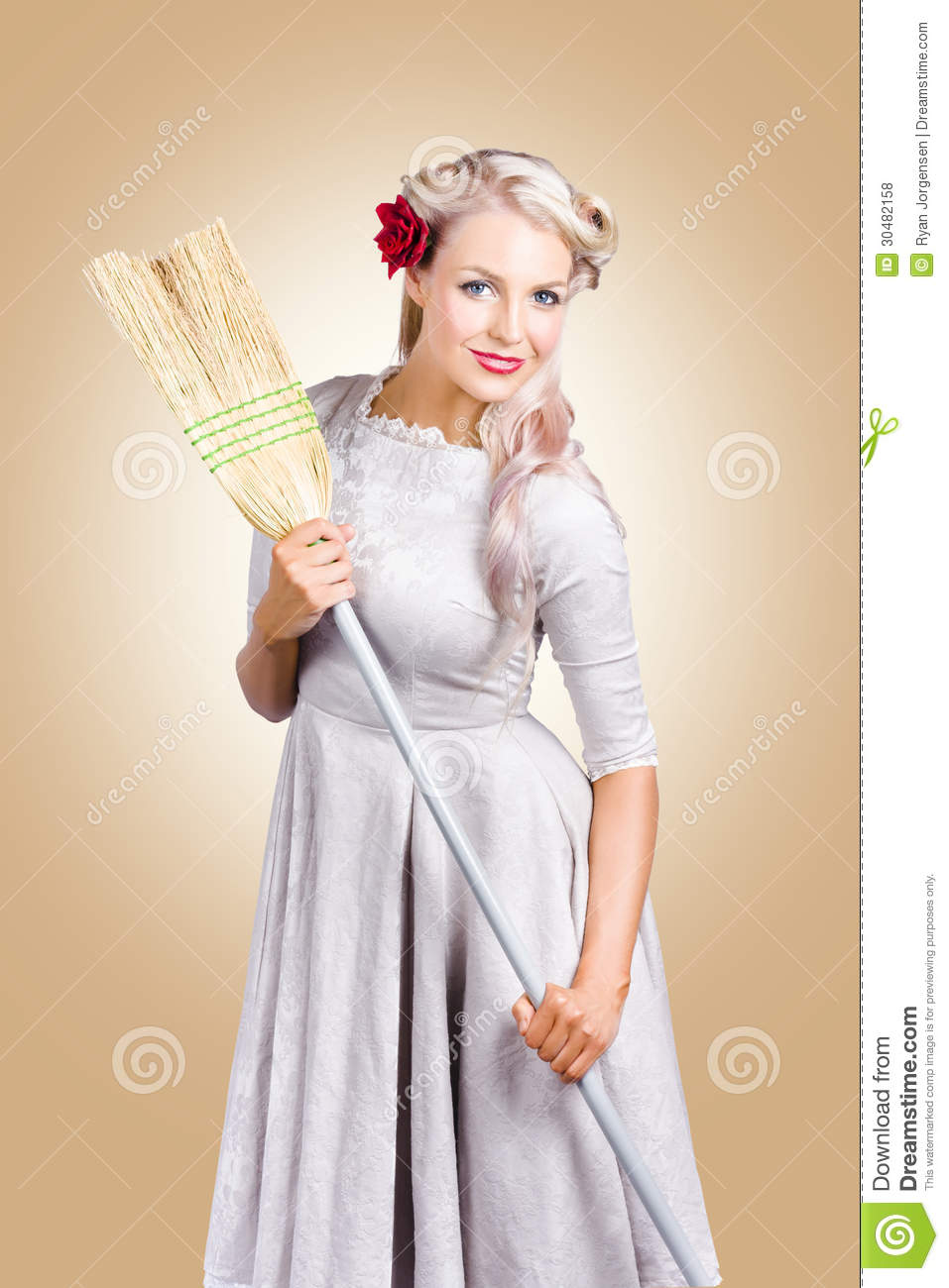 old fashion woman spring cleaning with broom stock photo