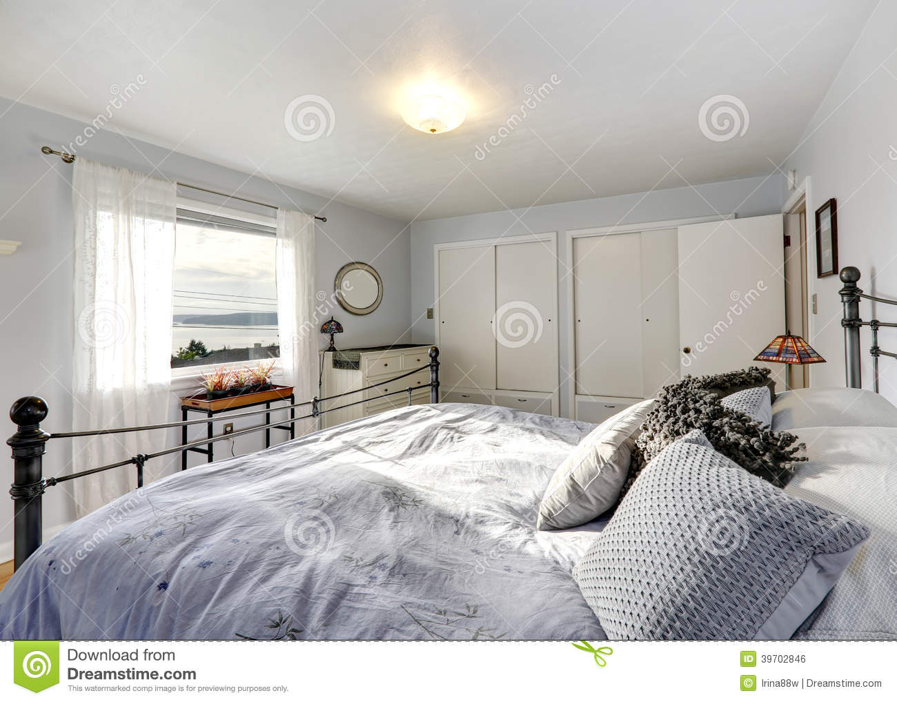 old fashioned bedroom with iron frame bed stock photo image