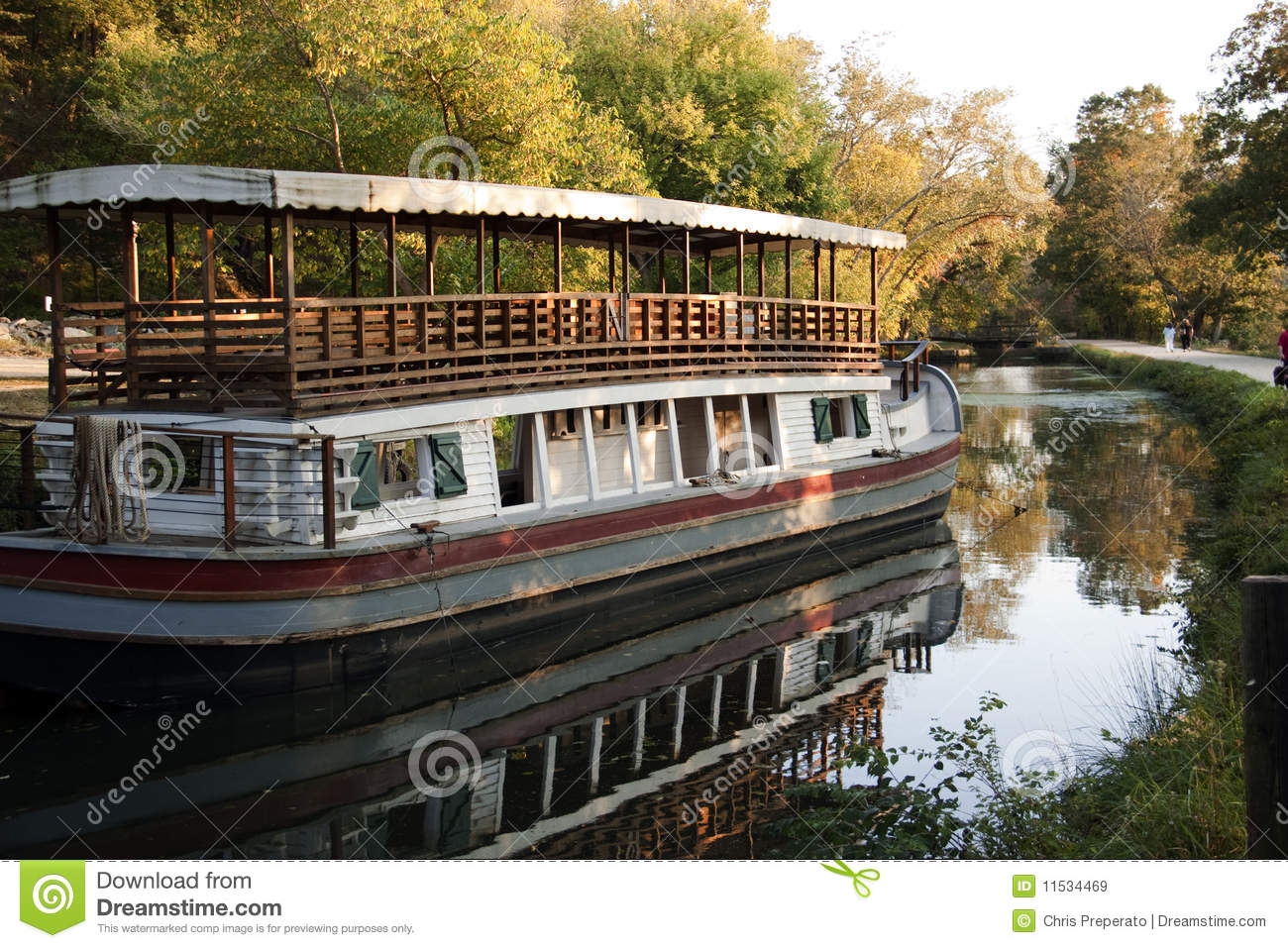 color photo of an old-fashioned canal boat along the C&O Canal ...