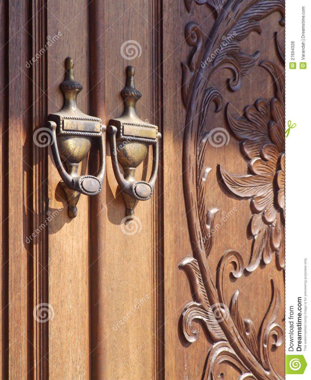 Old Fashioned Door Knocker With Carved Door Stock Photo