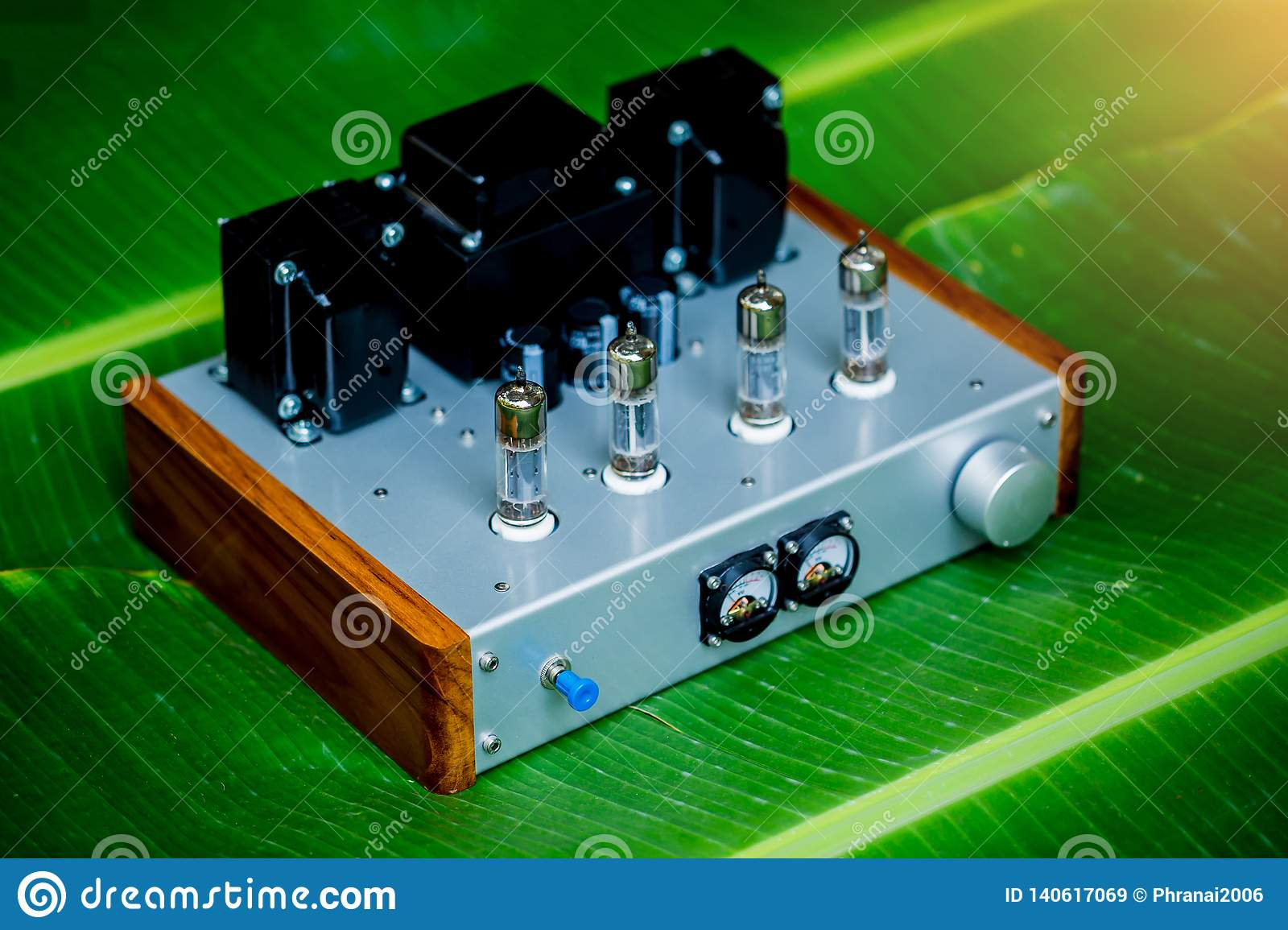 Old-fashioned Electronic Device Amplifier With Glowing Bulb