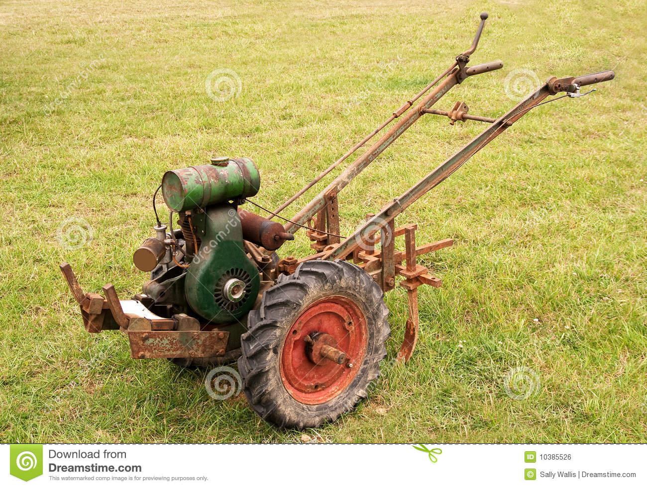 Old fashioned Garden Tiller Or Rotovator Royalty Free Stock Image
