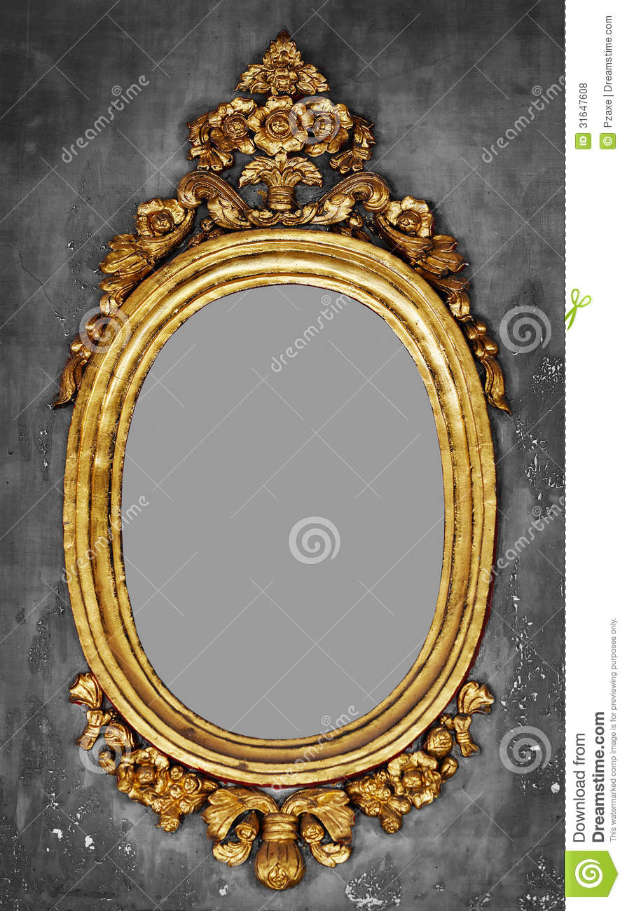 Old Fashioned Gilt Frame For A Mirror On A Concrete Wall