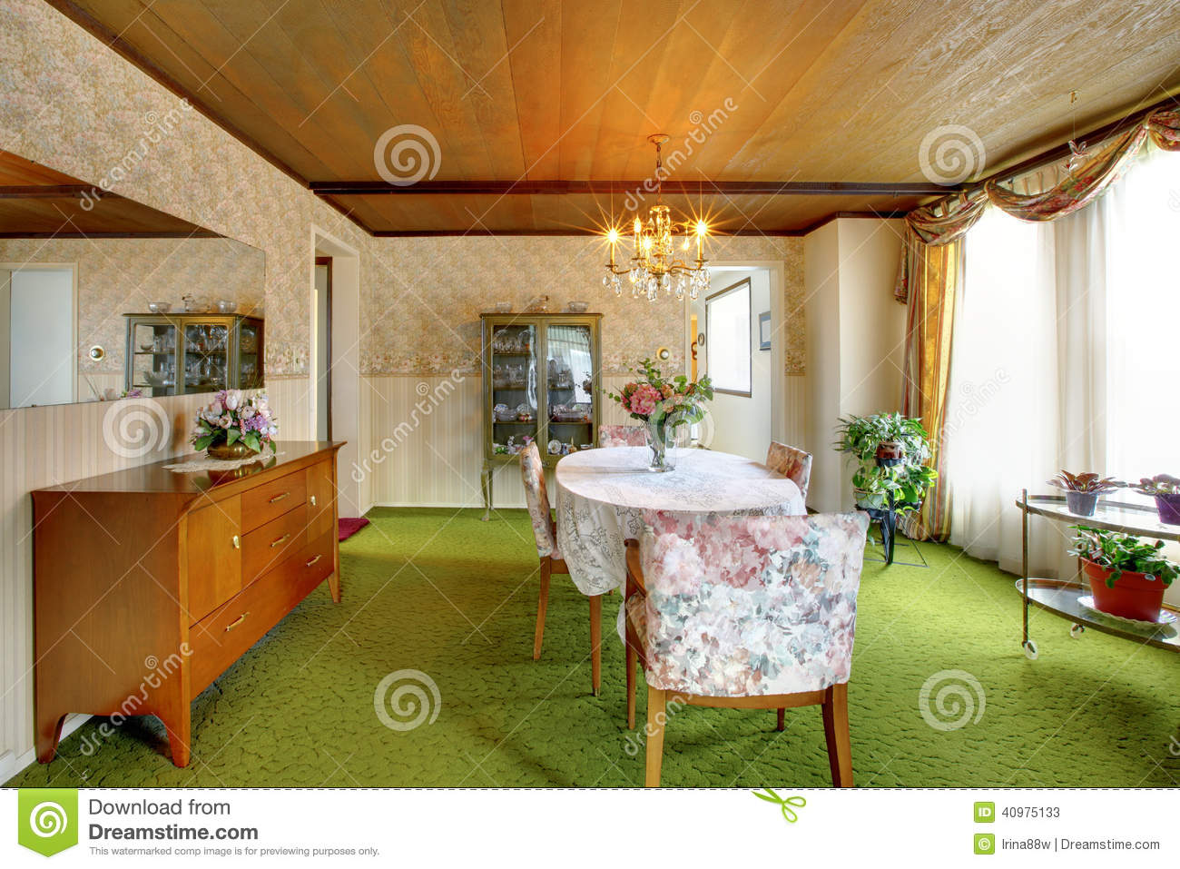 Old fashioned house interior with antique cabinets, green carpet floor