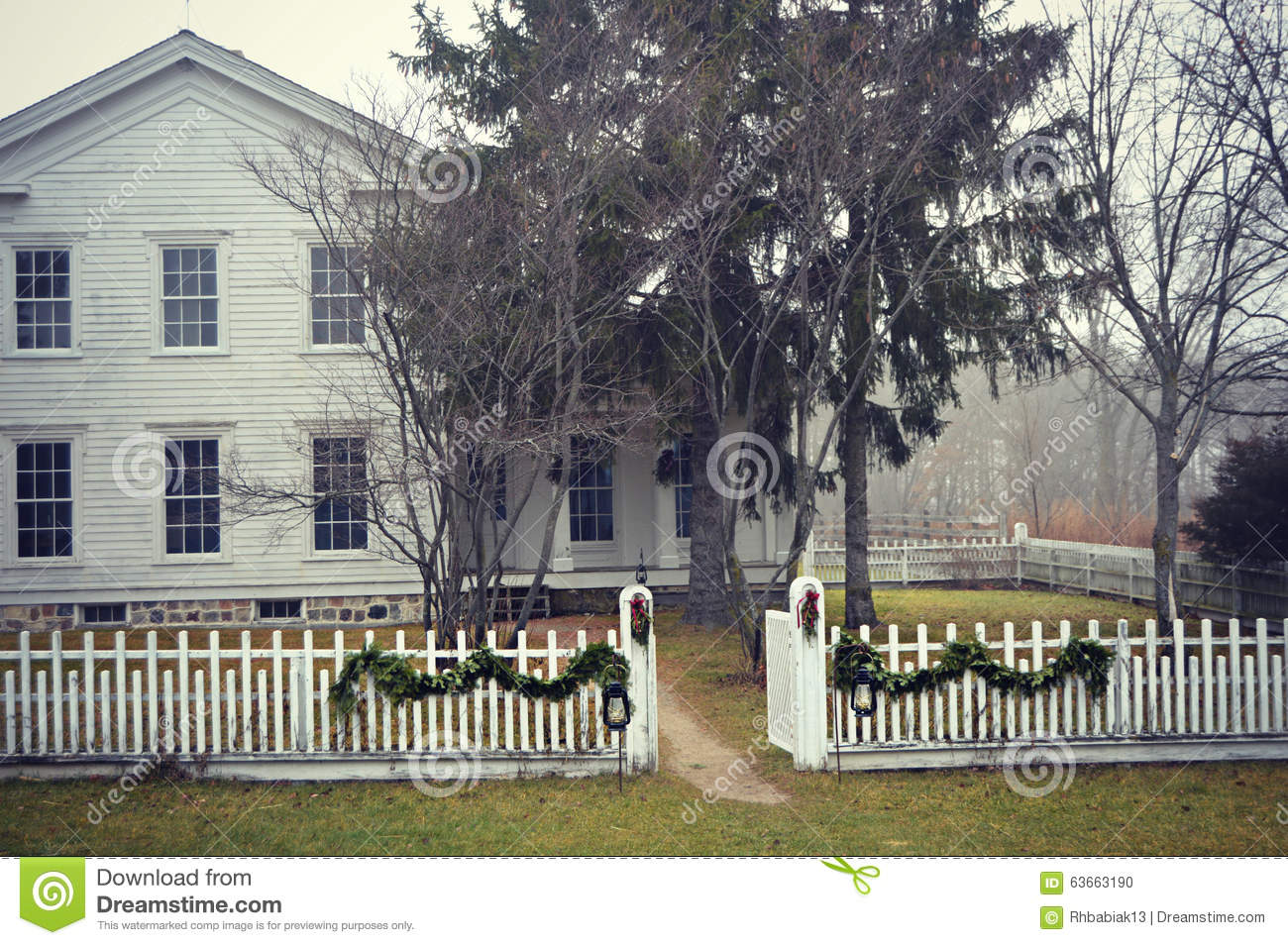 old fashioned house with white picket fence stock photo - image
