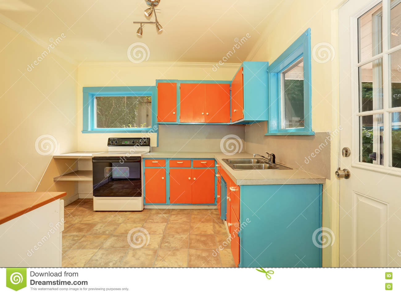 old fashioned kitchen interior with orange and blue cabinets