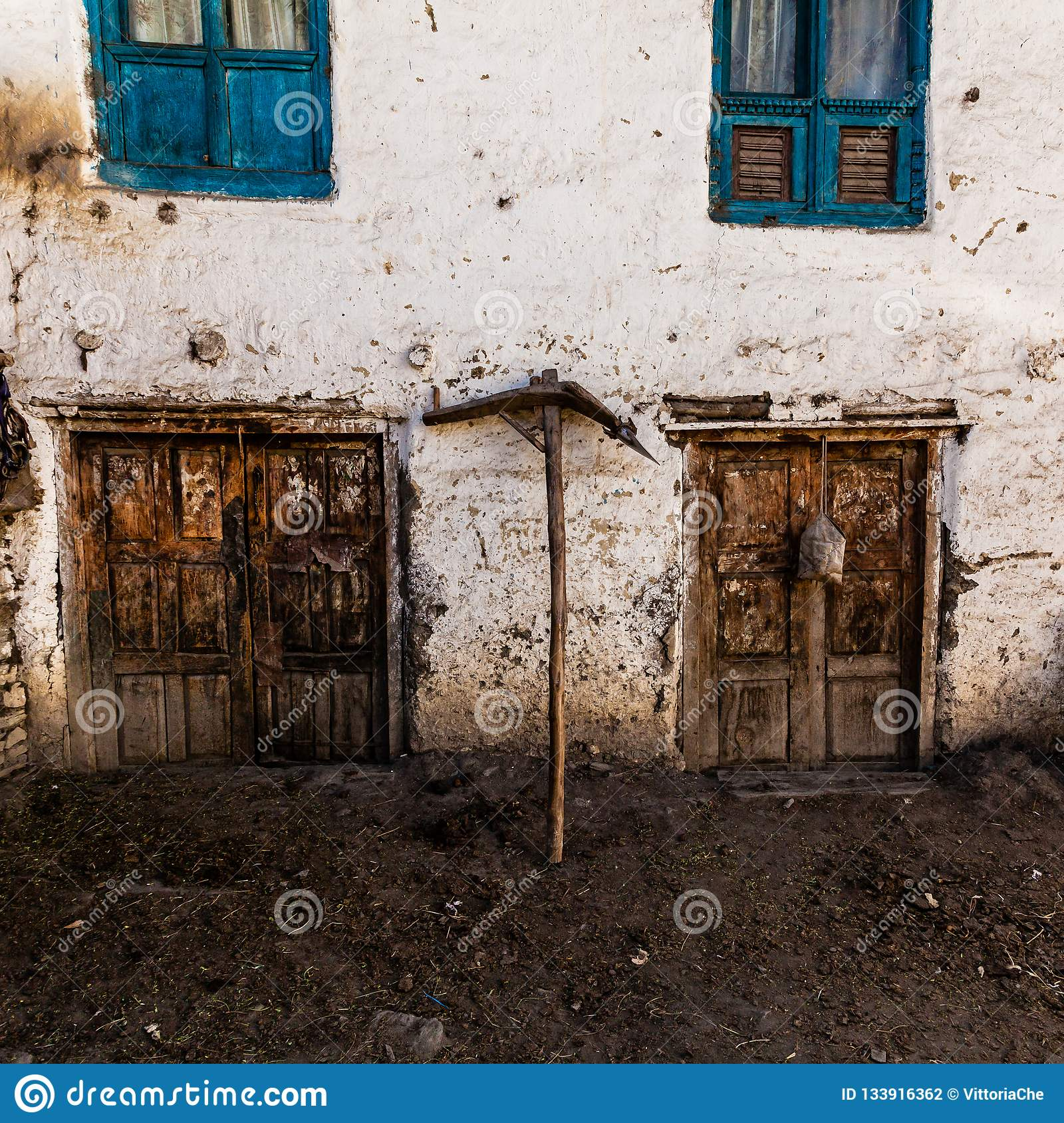 Old fashioned traditional dirty wood windows and doors in small mountain village in Nepal