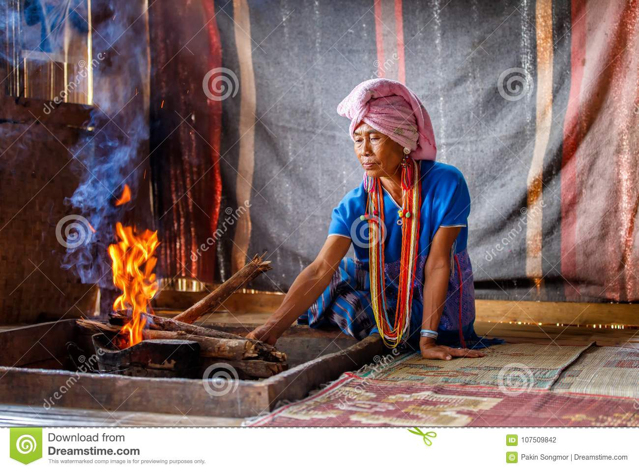 Old female karen hill tribe is cooking traditional in the cottage of northern Thailand at Mae Klang Luang