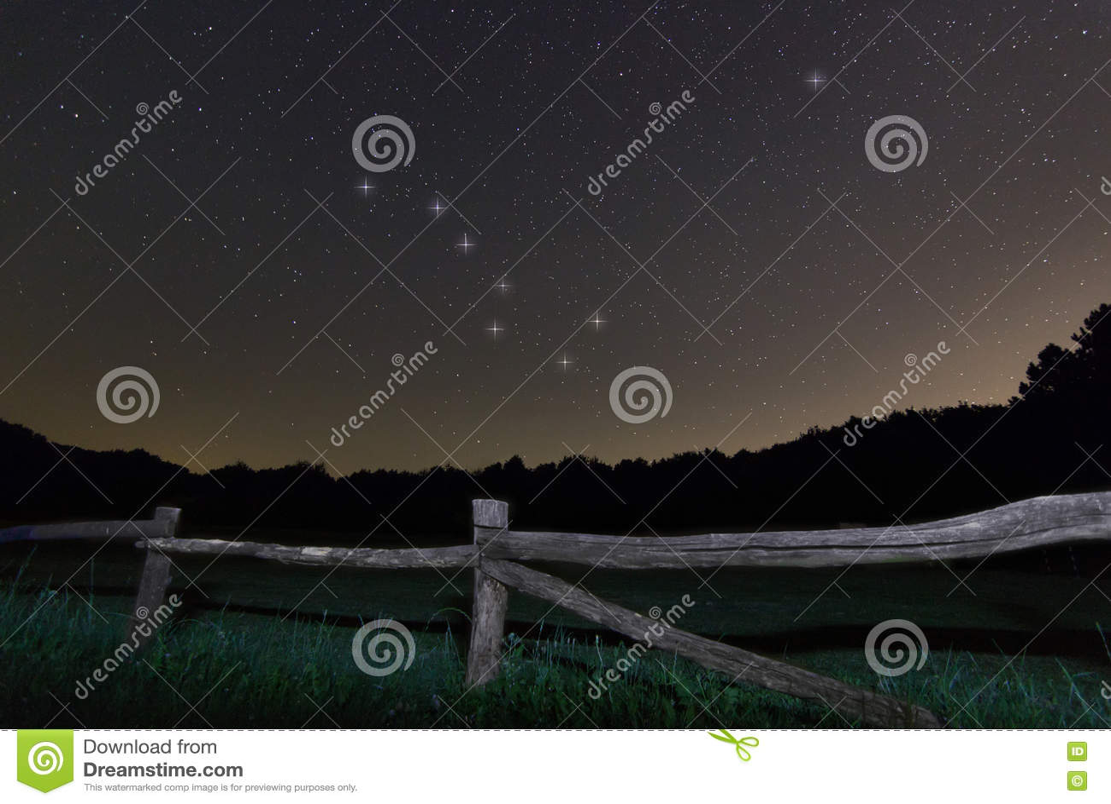 Old fence. Starry night Polaris star, Ursa Major,Big Dipper constellation Beautiful night sky.