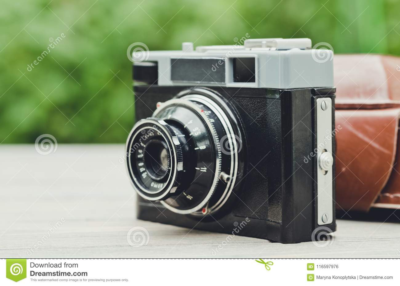 Old Film Camera On The Background Of The Spring Garden ...