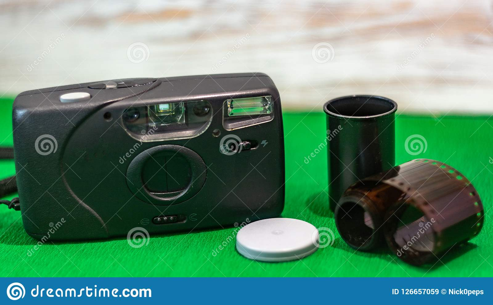 Old film camera film on a green background