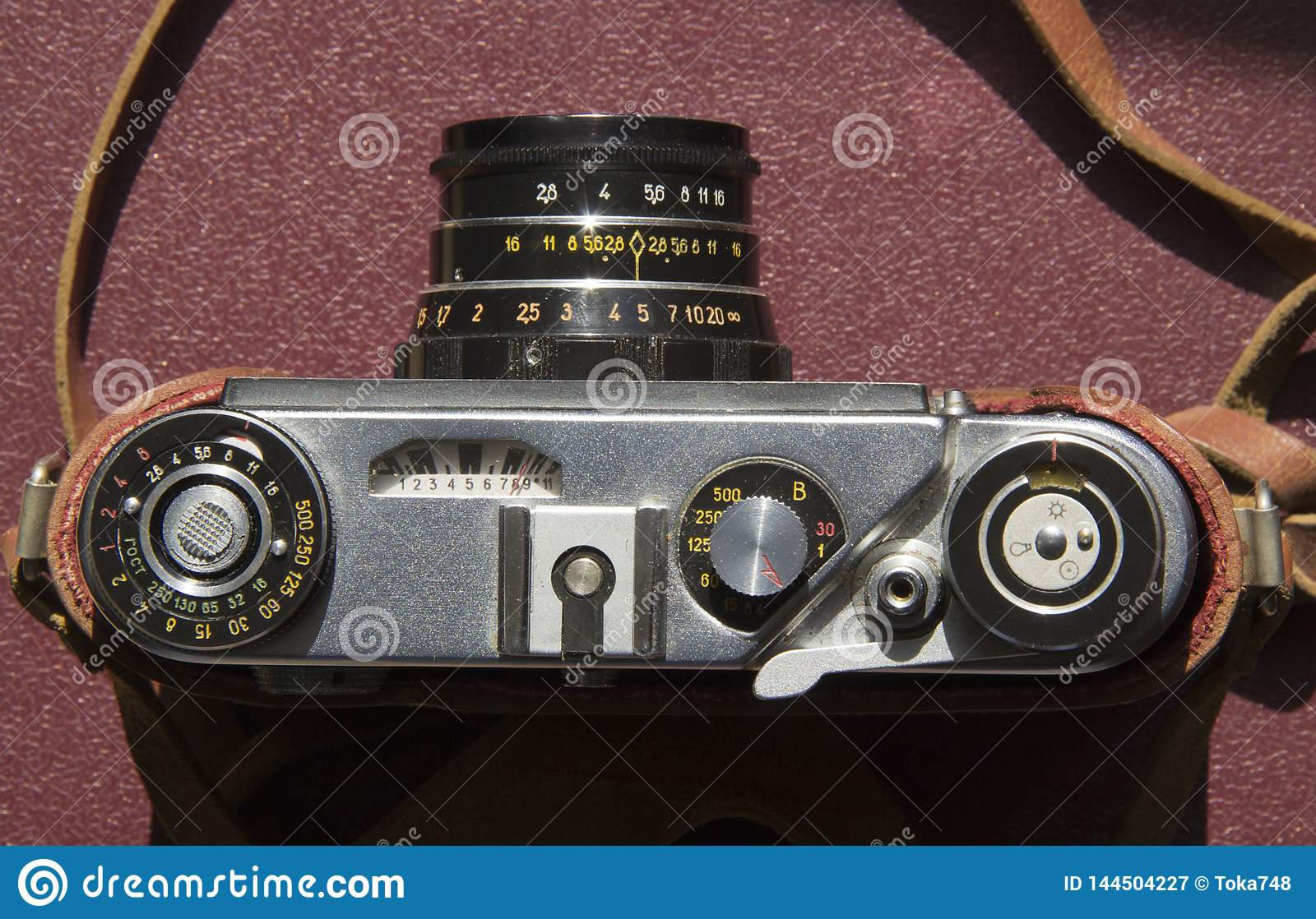 Old film camera on the table