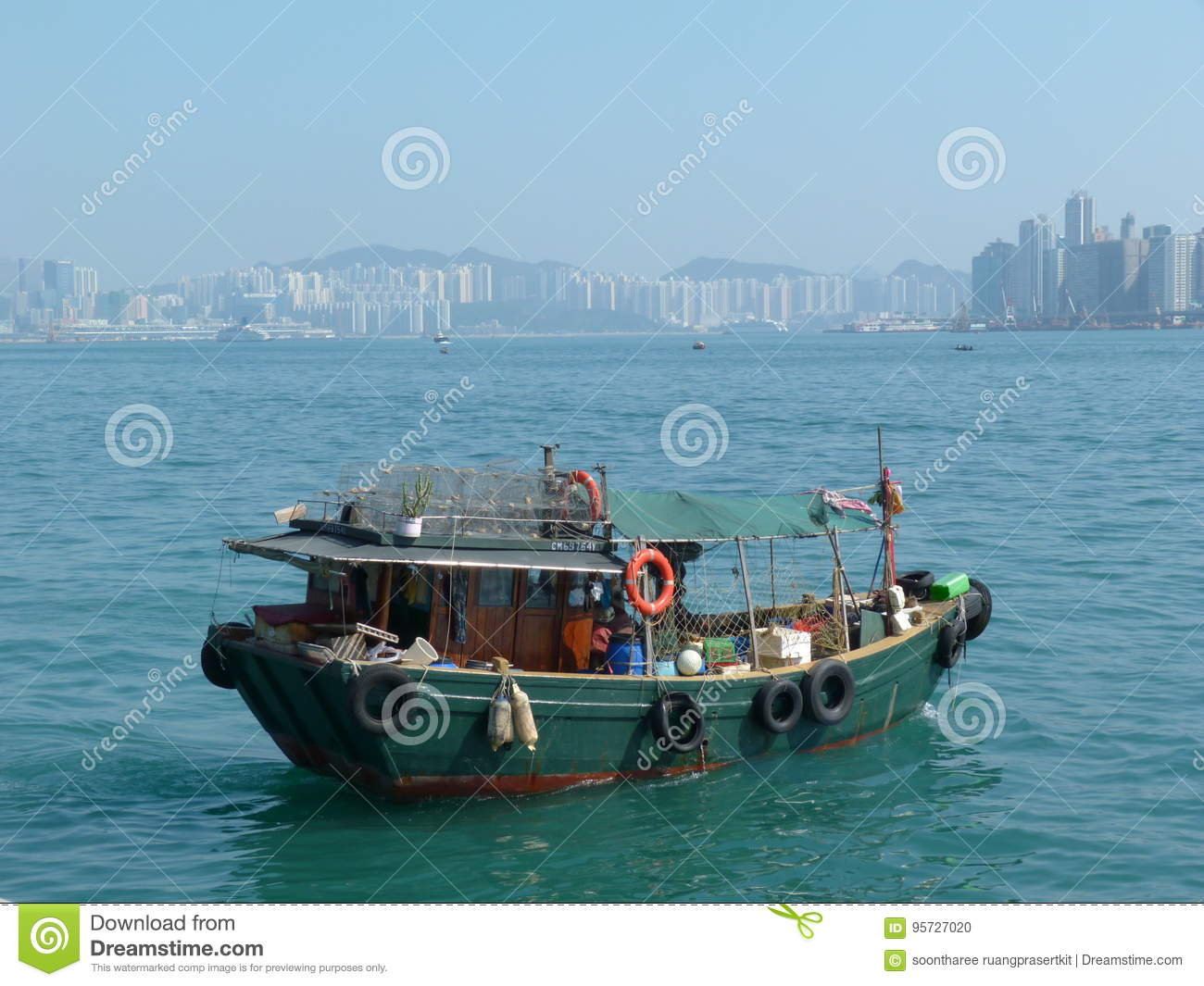 Old fisherman boat with tall building back ground