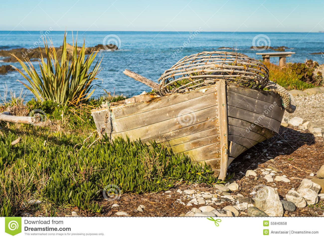 Old Fishermans Boat With A Lobster Trap On A Beach Stock Photo - Image: 55840658