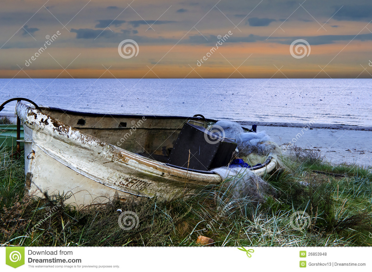 old fishing boat before sunrise baltic sea royalty free stock