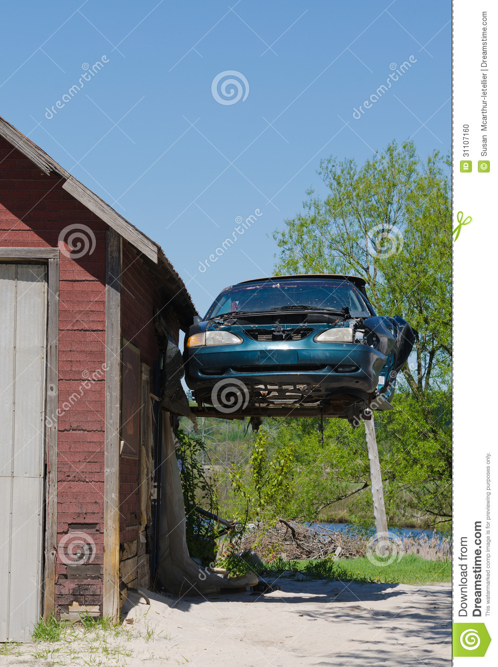 Old ford mustang hanging from garage stock photo image for Garage ford vernouillet