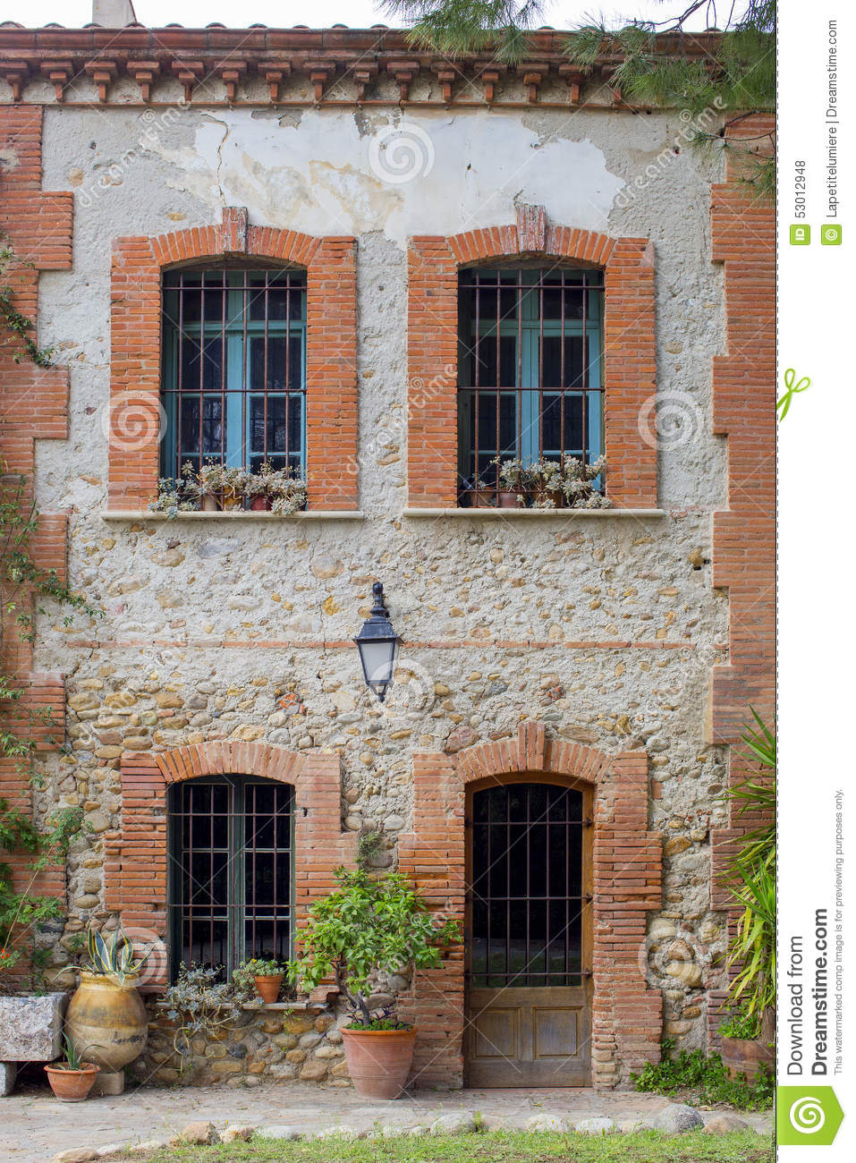 Old french house exterior made by brick with door and for Brick front house cost
