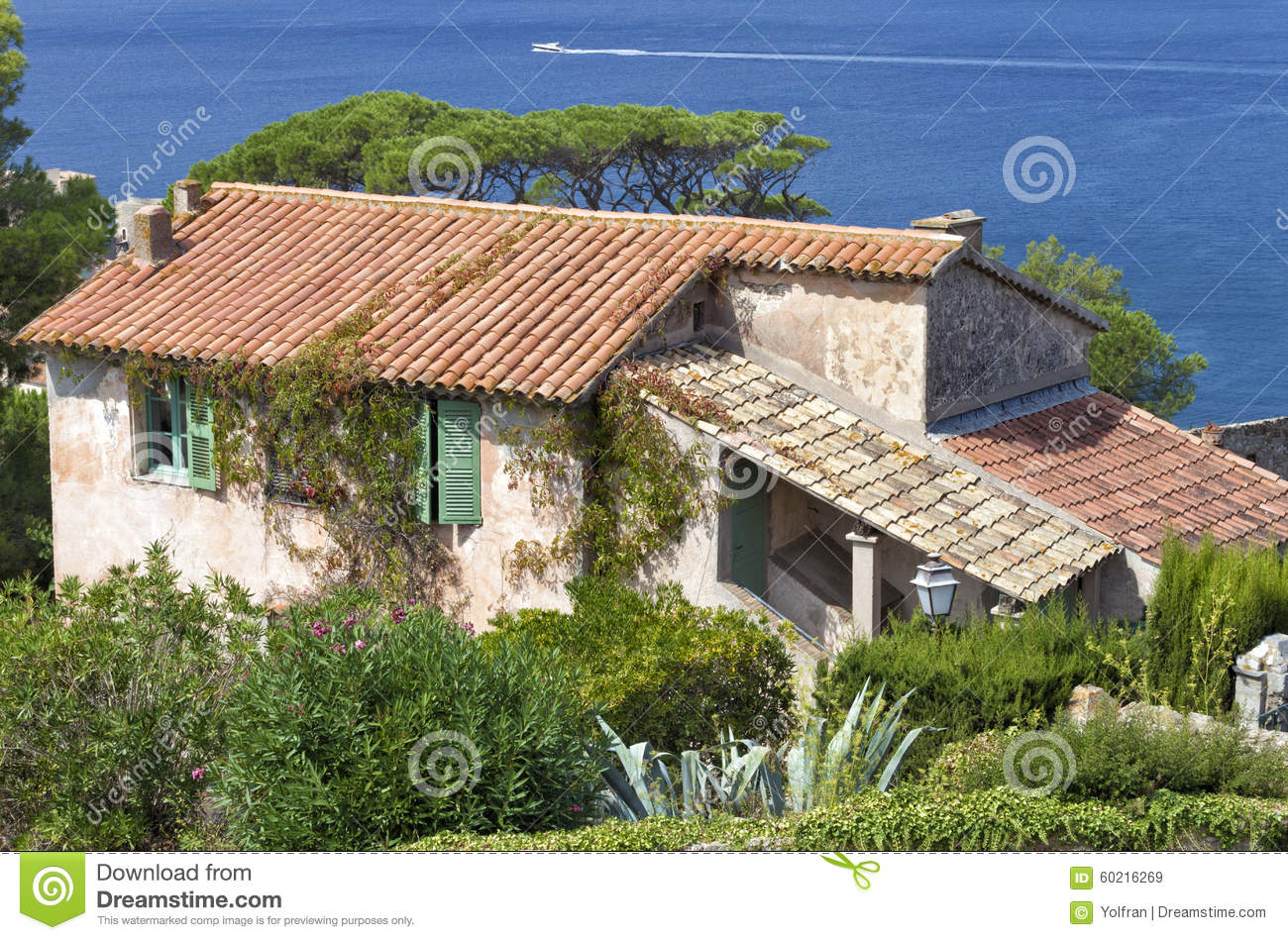 Old french rustic villa by the sea with garden stock image for French mediterranean house