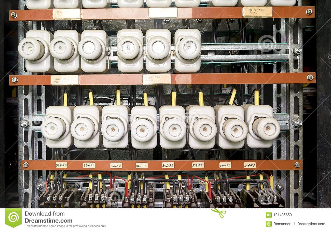 An old fuse box with cables and contactors. Old electrical panel,  electrical box,